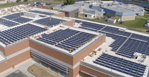 aerial photo of new net zero building solar panel roof
